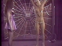 Blonde gets tied on a web naked