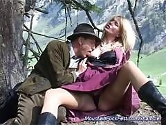 Busty Blonde Is In The Mountains Outside Blowing And Ass Fucking