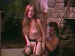 Luscious blonde dame turned on by fire