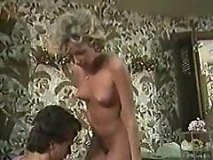 Candie Evans fucks Peter North in the bathroom